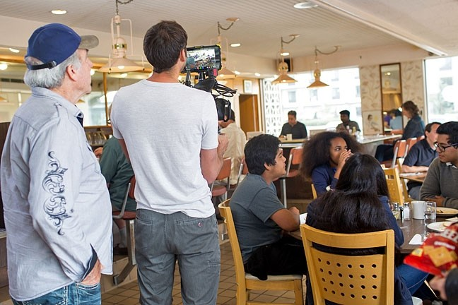 A GROUP EFFORT:  Bryan Duggan (far left) directs on set of 'One with Everything' at Margie's Diner in SLO. The cast and crew of the short film all donated their time and talents for free. - PHOTO COURTESY OF BRYAN DUGGAN