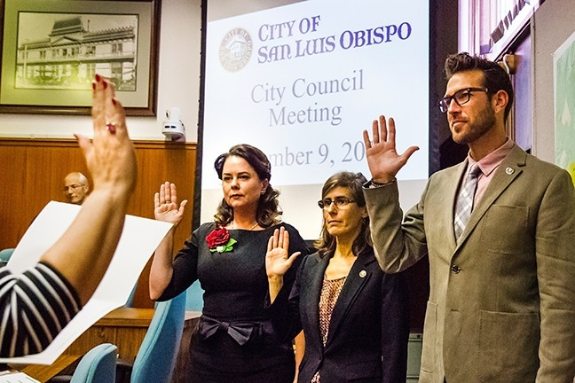ROCK THE VOTE:  SLO County voters turned out in record numbers to make their voices heard in a controversial election year on the national, state, and local level. Left to right, new SLO Mayor Heidi Harmon and new City Council members Andy Pease and Aaron Gomez were sworn into office in December. - FILE PHOTO BY JAYSON MELLOM