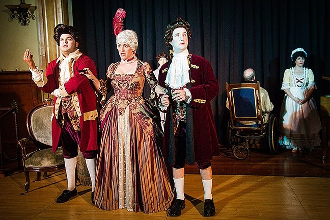 LIKE THE WIND :  Salieri's venticellos (from left: Edgar De La Cruz, Claire Fundaro, and Sean McCallon), or little winds, bring him the latest gossip about Mozart. - PHOTO BY JAYSON MELLOM