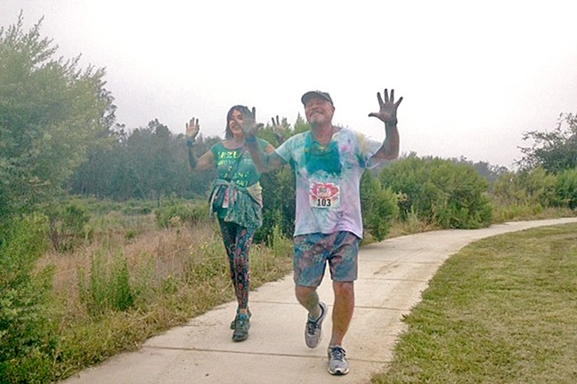 FUN RUN:  Runners like these smiled as they were dowsed in colorful powder at Orcutt Community Park Aug. 6. - PHOTO BY CHRIS MCGUINNESS