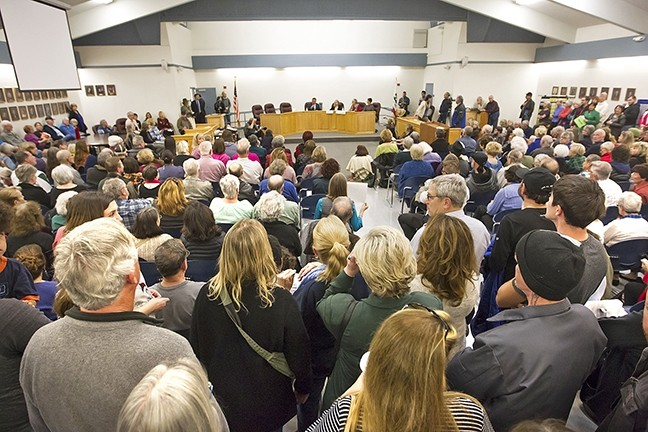 FULL HOUSE:  Large crowds of Central Coast residents turned out to town hall meetings held by U.S. Rep. Salud Carbajal (D-Santa Barbara), who's pictured, and state Assemblymember Jordan Cunningham (R-SLO). - PHOTO BY JAYSON MELLOM