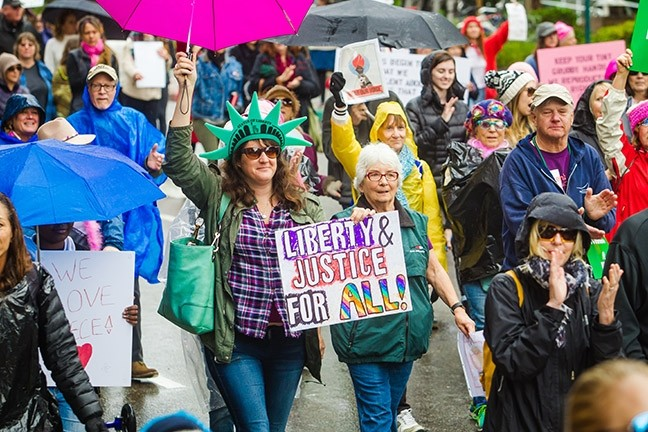 ON THE MARCH:  The SLO Women's March drew thousands and helped spark a renewed interest in political activism in SLO County. - PHOTO BY JAYSON MELLOM