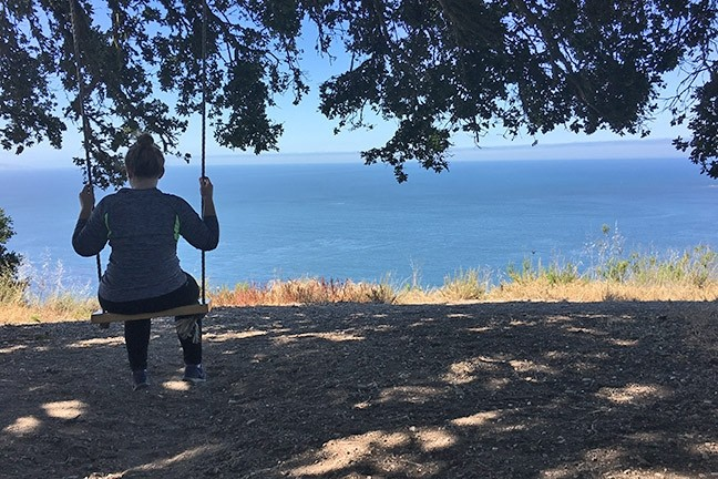 SWINGING:  Sara Deleon takes a moment to soak in the views while swinging her troubles away. - PHOTO BY KAREN GARCIA