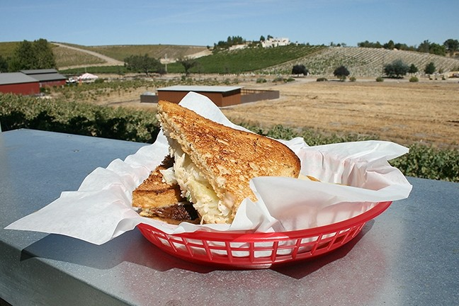 LOUNGE WITH A VIEW:  The view from Barton Family Wines' new outdoor lounge area is pretty epic. So is this brisket Reuben sandwich, crafted by Chef Jeffry Wiesinger of Jeffry's Catering, located onsite. - PHOTO BY HAYLEY THOMAS CAIN