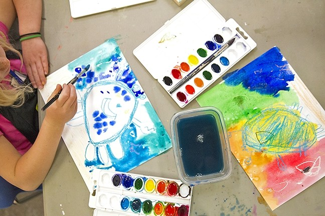 ARTIST IN TRAINING:  Veda Baker, a first grader at Virginia Peterson Elementary School in Paso Robles, takes her time painting the ocean backdrop of her crab painting at an art class at Studios on the Park. - PHOTO BY JAYSON MELLOM