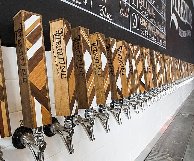 HOP OFF AND TUNE IN:  Hop On Beer Tours owner Brant Myers is offering a new, 1-mile walking tour that encompasses four breweries, lunch, and a bit of interesting San Luis Obispo Prohibition era history. Pictured, Libertine Brewing Company, the last stop on the tour. - PHOTO BY JAYSON MELLOM