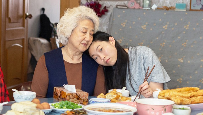 SAYING GOODBYE Chinese-American Billi (Awkwafina, right) returns to China when her grandmother, Nai Nai (Shuzhen Zhao) is diagnosed with terminal cancer, in The Farewell. - PHOTO COURTESY OF BIG BEACH FILMS