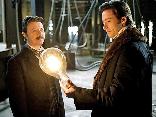 "MAJOR TESLA TO GROUND CONTROL Nikola Tesla (David Bowie) shows magician Robert Angier (Hugh Jackman) a thing or two about ""real magic,"" in director Christopher Nolan's 2006 psychological thriller, The Prestige. - PHOTO COURTESY OF TOUCHSTONE PICTURES"