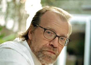 George Saunders reads from his novel onstage at the PAC