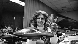 PHOTO COURTESY OF DUPLASS BROTHERS PRODUCTIONS - COMPLICATED Was Elizabeth Carmichael a larger-than-life entrepreneur who aimed to upend the automobile business with a unique three-wheeled car called The Dale, or was she a con artist, and was she really a he? Watch The Lady and The Dale on HBO Max and decide for yourself.