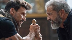 PHOTO COURTESY OF WARPARTY FILMS AND SCOTT FREE PRODUCTIONS - 249 WAYS TO DIE Ex-Special Forces operative Roy Pulver (Frank Grillo, left) faces off against Col. Clive Ventor (Mel Gibson), in Boss Level, a time-loop action flick on Hulu.