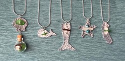 Learn how to texturize metal and drill holes in sea glass. - Uploaded by Joan Martin Fee
