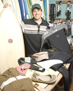 PHOTO BY STEVE E. MILLER - CHANGING THE WORLD :  Ryan Milliman hopes that the Earth-friendly boards and more that he offers through the Shell Beach Surf Shop and the online Seahuggers will push the industry toward preserving the ocean.