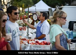 PHOTO BY STEVE E. MILLER - MARKET BATTLE  :  The city steps in to break the deadlock between SLO Farmers' Market Association and the SLO Downtown Association in the struggle over who should manage farmers at the SLO Thursday night farmers' market.