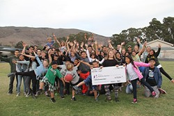 PHOTO COURTESY OF HELEN SAULSBURY - CHECK!:  The elementary school students who are part of Big Brothers Big Sisters in San Luis Obispo hold up their $80,000 check from the Harold J. Miossi Charitable Trust, which funds one of their programs.