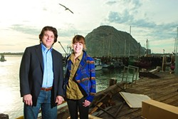 PHOTO BY STEVE E. MILLER - FISH FINDERS:  Joe Falcone, founder of Phondini Partners, met up with his local Outreach and Education employee Gayle Buffo in Morro Bay to showcase their new app Fishline.
