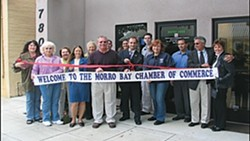 FILE PHOTO - NOT IN THE NEAR FUTURE :  City officials joined Charles Lynch for a ribbon cutting when he opened a medical marijuana dispensary there several years ago. The City of Morro Bay recently continued a moratorium on new dispensaries