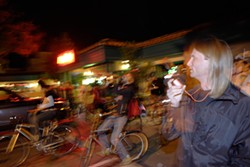 DRIVE-BY PARTY :  Jevon Pyl leads a pack of bike riders in celebration of the inauguration. - PHOTO BY STEVE E MILLER
