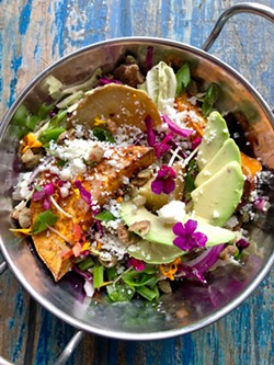 PHOTO BY COURTESY OF VEGETABLE BUTCHER - MADE WITH LOVE Vegetable Butcher in downtown SLO is hosting a free Thanksgiving dinner for fire victims. Included is this dish: A spring yam, avocado, and cabbage slaw with rosemary, poblano, queso fresco, pepitas, and flower petals.