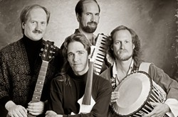Ancient Future circa 1990. Pictured: Matthew Montfort (guitars), Jim Hurley (violin), Doug McKeehan (keys), Ian Dogole (percussion). - Uploaded by Matthew Charles Montfort