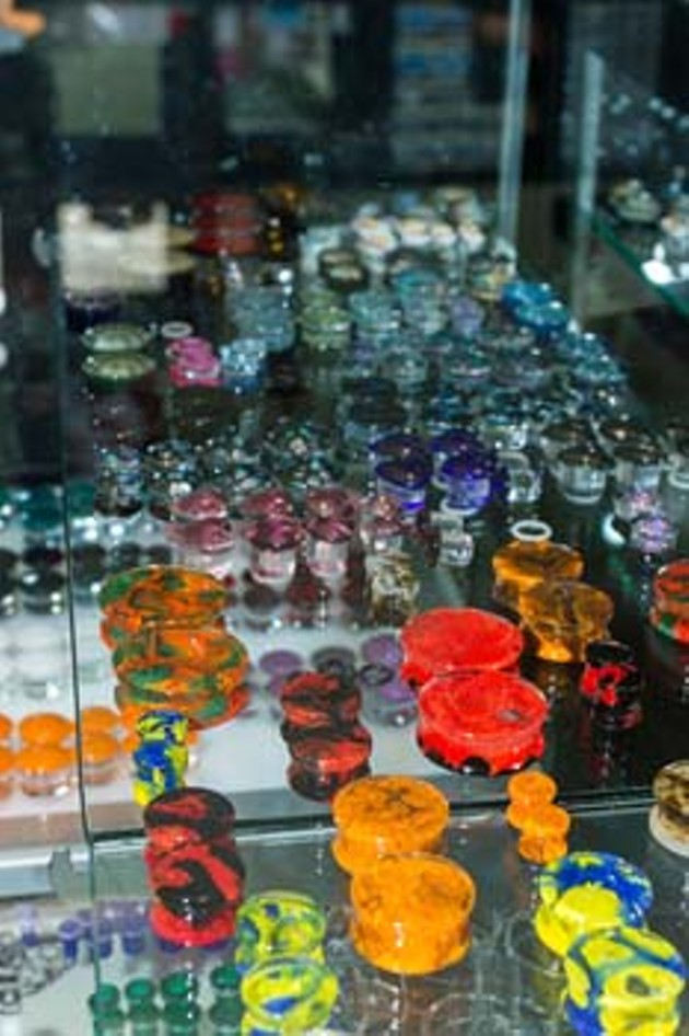 Display cabinet of various ear plugs at 23rd Street Body Piercing in Oklahoma City. Best place to get needled 2015. Thursday, August 6, 2015. (Keaton Draper)