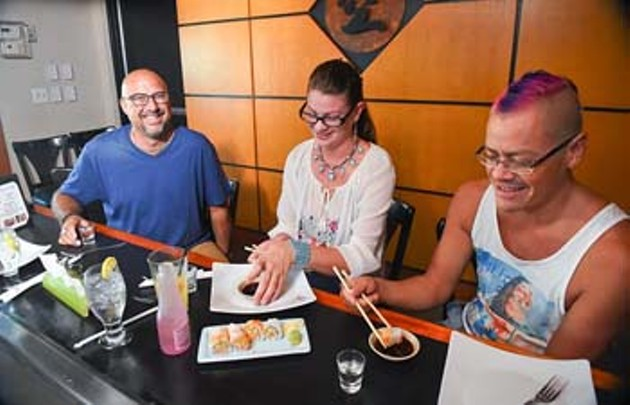 From left, Stan, Tamara and Miguel enjoy sake an sushi at Musashi Japanese Steakhouse.  mh