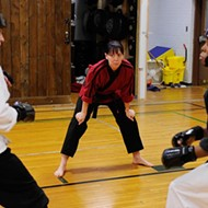 Students are kicking class with martial arts training