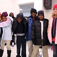 Parks Elementary School students strike a pose after receiving new gloves, beanies and winter coats through The Foundation for Oklahoma City Public Schools' Coat-A-Kid program.
