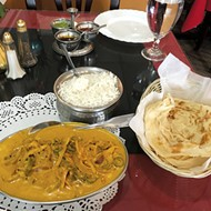 Malabar fish curry with <i>kerala paratha</i>, a layered flatbread from southern India