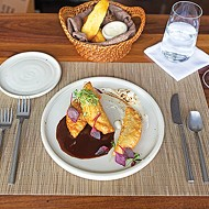 Short rib <i>empanadas</i> with goat cheese and ancho chile <i>demi-glace</i>