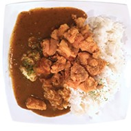Japanese curry served with chicken <i>karaage</i> and white rice
