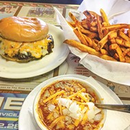 A cup of chili with a sausage burger and a half order of fries at Ron's Hamburgers & Chili in Oklahoma City