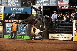 JB Mauney attempts to ride Wolf Creek/Shepherd Hills Cutlery/Tom Luthy's Shepherd Hills Stockman during the championship round of the Oklahoma City Built Ford Tough series PBR. Photo by Andy Watson - ANDY WATSON