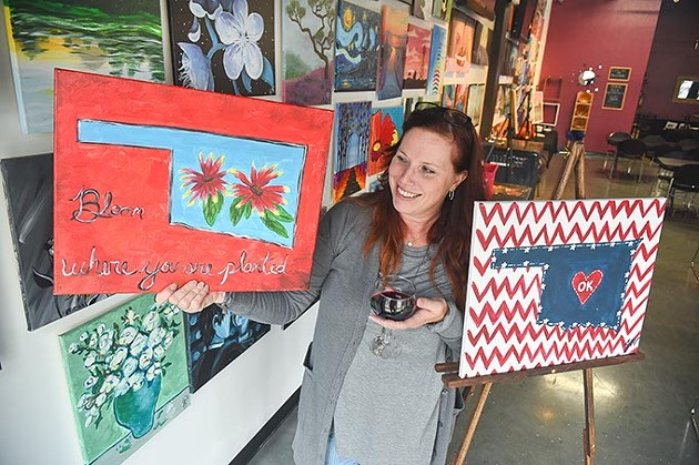"""Marie Ensign, owner of Wine & Palette, with a couple of the """"Pick One"""" state themed paintings guests can paint during the NAMI Oklahoma fundraiser, at Wine & Palette, 201 N.W. 10th Street, 11-4-15. - MARK HANCOCK"""