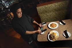 Chef Nordeen Bennai photographes 2 dishes he just created for the Gazette photo shoot, ruby rainbow trout, above, and Scampi gyro platter, at Zorba's.  mh