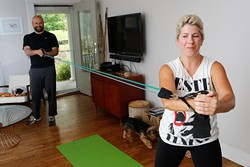 Rick Thomas trains Ben and Ashley Sellers at their home in Oklahoma City. (Garett Fisbeck)