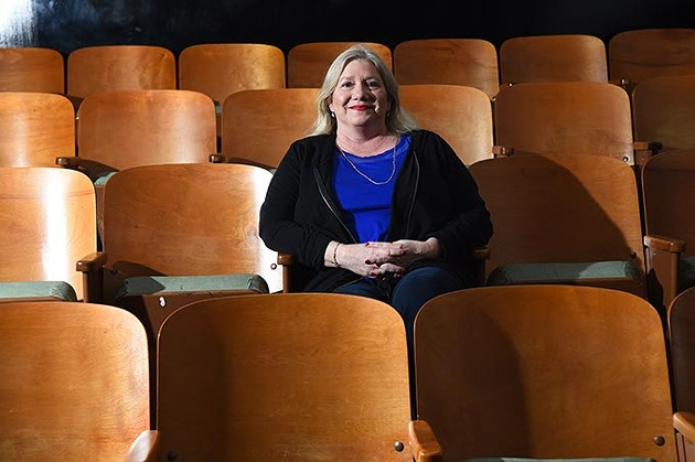 Recently divorced Tammy McKee might just attend a movie alone this Valentines Day, shown illustrating this idea at the Paraamount OKC theater, Film Row, Oklahoma City, 1-26-16. - MARK HANCOCK