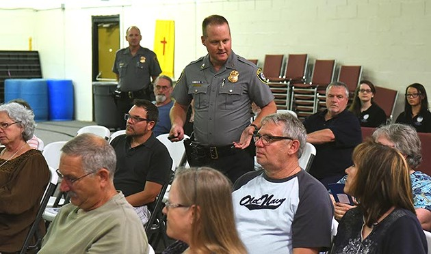 "Master Sargent Robert Henderson engages the crowd, Thursday night during a ""Crime Prevention Through Environmental Design"" workshop in south OKC.  mh"