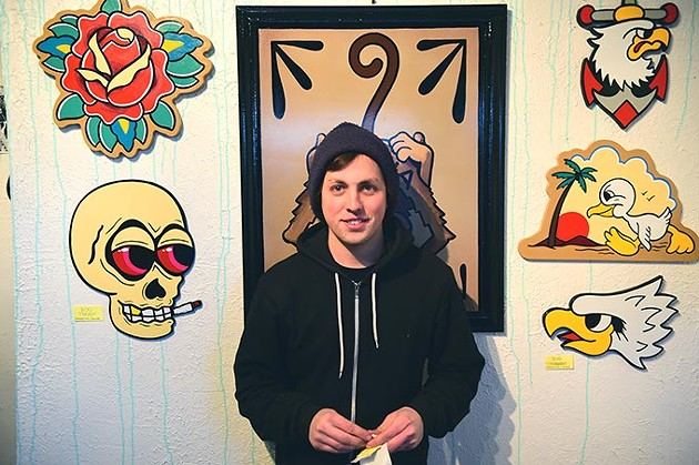 Tanner Frady in front of his art during the opening at Tall Hill Creative gallery on 2-1-15.  mh