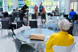 Library patrons watch the Kanaga Piano Jazz Quartet's Noon Tunes performance. - SHANNON CORNMAN