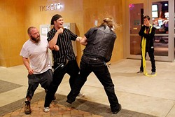 """Member of opposing Satanic groups fight outside a movie theatre following a showing of """"The Real Enemy"""" during the DeadCENTER Film Festival at Harkins Theatre in Oklahoma City, Thursday, June 11, 2015.  (Garett Fisbeck) - GARETT FISBECK"""