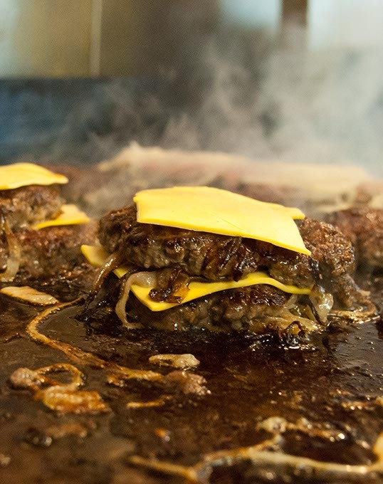 Double Onion Burger on the grill (Mark Hancock)