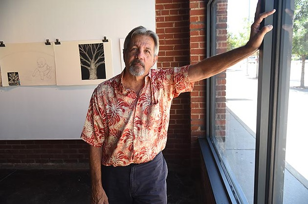 """Artist George Oswalt photographed at IAO Gallery on Film Rom where he was found working on the """"The Elaborate Colaborate"""" exhibit set-up.  mh"""