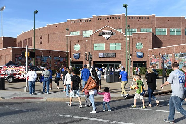 Fans arrive for the season opener at the Chickasaw Bricktown Ballpark with the OKC Dogers vs Round Rock Express, 4-9-15.  mh
