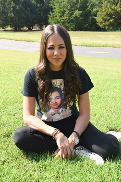 Mandi Leegard poses with her deceased boyfried's picture on a tee shirt, in the back yard of her Coffee Creek, Edmond home, 10-7-15. - MARK HANCOCK