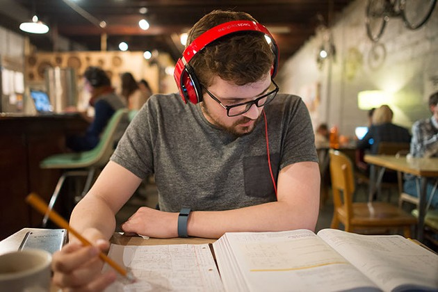 Christian Almonrode, 21, a junior at the University of Oklahoma majoring in Aerospace Engineering, studies at Gray Owl cafe in Norman, Oklahoma, March 10, 2015. - CHRISTIAN WILSON