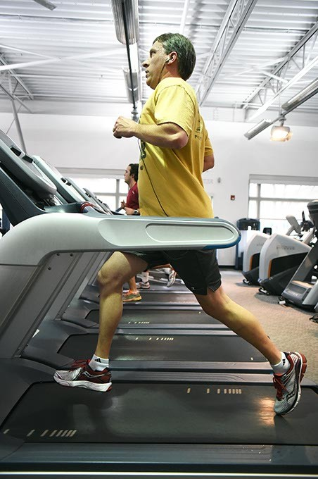 A man works out on a treadmill at the Downtown YMCA in Oklahoma City, 1-7-16. - MARK HANCOCK
