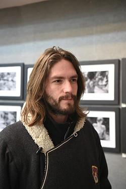 Butoh photographer David Joshua Jennings, with his exhibit at Paseo Gallery One, 1-5-15. - MARK HANCOCK
