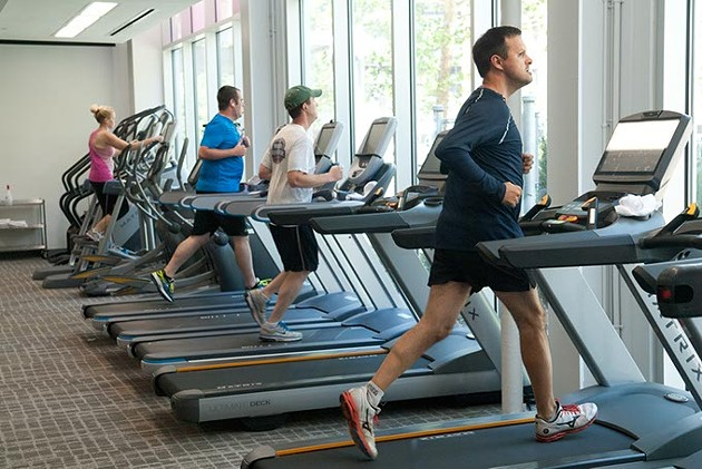 Patrons working out during the lunch hour recently at the Main Street YMCA.  mh