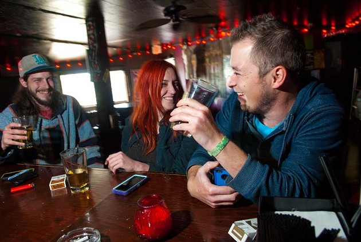 From left, Brandon Porter, Zak Corbett and Dustin Graeber, enjoy the afternoon drinking at Drunke Fry recently. (Mark Hancock)